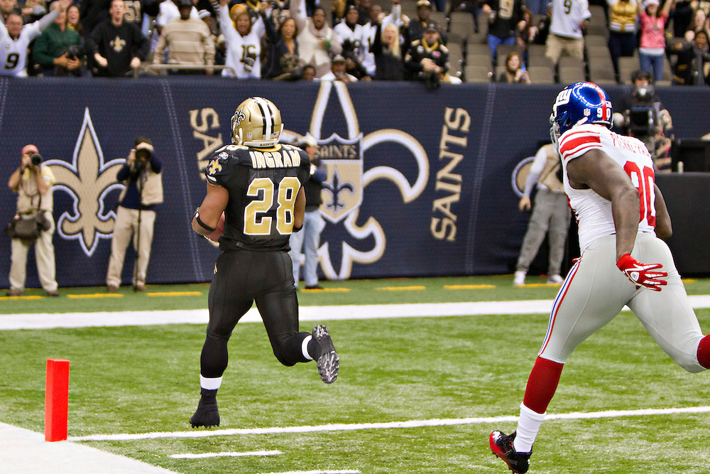 NEW ORLEANS, LA - NOVEMBER 28:   Mark Ingram #28 of the New Orleans Saints runs the ball in for a touchdown against the New York Giants at Mercedes-Benz Superdome on November 28, 2011 in New Orleans, Louisiana.  The Saints defeated the Giants 49-24.  (Photo by Wesley Hitt/Getty Images) *** Local Caption *** Mark Ingram