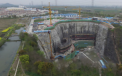 The construction site of a quarry hotel is seen in Songjiang District of Shanghai, east China, April 5, 2016. With an altitude of minus 80 meters, the Shimao quarry hotel is China's first 5-star hotel being built into an abandoned quarry. Estimated to be finished in 2017, the hotel has 370 guest rooms in its 2 underwater storeys, 17 underground storeys and 2 above ground storeys. EXPA Pictures © 2016, PhotoCredit: EXPA/ Photoshot/ Ding Ting<br /> <br /> *****ATTENTION - for AUT, SLO, CRO, SRB, BIH, MAZ, SUI only*****