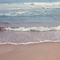 Ocean waters along the sand.