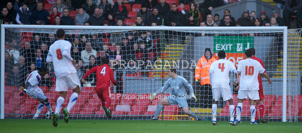 LIVERPOOL, ENGLAND - Saturday, January 8, 2011: Liverpool's goalkeeper Tyrell Belford is beaten by Crystal Palace's Ibra Sekajja for the opening goal during the FA Youth Cup 4th Round match at Anfield. (Pic by: David Rawcliffe/Propaganda)