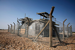 UK ENGLAND DUNGENESS 24MAR12 - Derelict and condemned structure at Dungeness shingle beach on the Kent coast. It is the  largest area of open shingle in Europe, measuring 12 km by 6 km, which has been deposited by the sea and built up over thousands of years.....jre/Photo by Jiri Rezac....© Jiri Rezac 2012