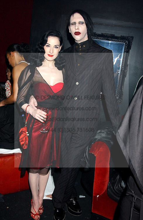 MARILYN MANSON and DITA VON TEESE at a party to celebrate the first issue of British Harper's Bazaar held at Cirque, 10-14 Cranbourne Street, London WC2 on 16th February 2006.<br /><br />NON EXCLUSIVE - WORLD RIGHTS