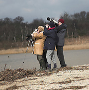 A group of four birdwatchers at Benacre Broad, Suffolk, England