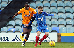 Danny Lloyd of Peterborough United in action with Temitope Obadeyi of Oldham Athletic - Mandatory by-line: Joe Dent/JMP - 20/01/2018 - FOOTBALL - ABAX Stadium - Peterborough, England - Peterborough United v Oldham Athletic - Sky Bet League One