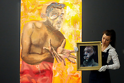 "© Licensed to London News Pictures. 21/06/2019. London, UK. A technician holds Francis Bacon's ""Self-Portrait"", 1975 (Est £15m- £20m) in front of Albert Oehlen's Selbstportrait Mit Leeren Handen (Self-Portrait with empathy hands) 1988 (Est £4m- £6m) at the preview of Summer Contemporary Art Auctions at Sotheby's George Street, London. Photo credit: Dinendra Haria/LNP"