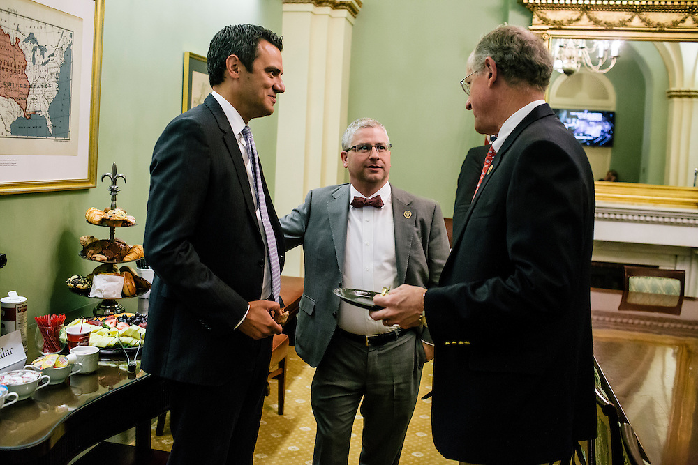 U.S. Rep. Patrick McHenry (R-N.C.), the chief deputy whip of House Republicans, meets with fellow republicans, including Rep. Kevin Yoder of Kansas, left, and Rep. Mike Conaway of Texas, right, at a weekly deputy whip meeting at the U.S. Capitol on April 23, 2015. McHenry is considered one of the fastest-rising stars of House Republicans.