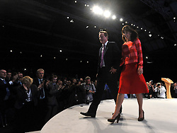 © Licensed to London News Pictures. 05/10/2011. MANCHESTER. UK.  Prime Minister David Cameron and his wife Samantha Cameron pose for photographs after the Prime Minister delivered his closing speech at The Conservative Party Conference at Manchester Central today, October 5, 2011. Photo credit:  Stephen Simpson/LNP