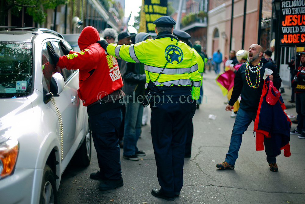 17 Feb 2015. New Orleans, Louisiana.<br /> Fat Tuesday. Mardi Gras Day. A Christian religious extremist is arrested by NOPD following an altercation in the french Quarter. <br /> Photo; Charlie Varley/varleypix.com