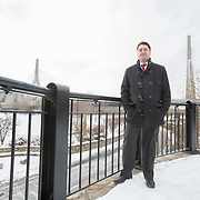 Boston City Councilor Josh Zakim poses for a portrait with the Zakim Bridge in the background at Paul Revere Park on January 26, 2015 in Charlestown, Massachusetts. (Photo by Elan Kawesch/The Times of Israel)