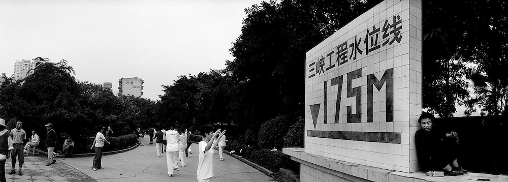 Women practicing Tai-chi in a city park, in front of a big sign indicated the leve to be reached by the Yangtze reservoir once the three gorges dam is completed in 2009.