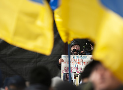 March 23, 2019 - Kyiv, Kyiv Oblast, Ukraine - A man who lost a family member in the Donbas War seen speaking during the demonstration. .Protesters gathered in Maidan Square then marched to the Presidential Administration building to call on President Petro Poroshenko to bring corrupt governmental officials to justice. With the Ukrainian Elections being held at the end of March the political tensions run very high. (Credit Image: © Matthew Hatcher/SOPA Images via ZUMA Wire)
