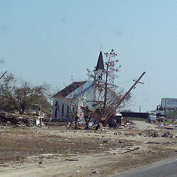 A church in Empire, Louisiana is the only building left standing on the block following the aftermath of Hurricane Katrina that flooded the small city of Buras, Louisiana in Plaquemines Parish on August 29, 2005. ..(Mandatory Credit: Photo by Derick E. Hingle)