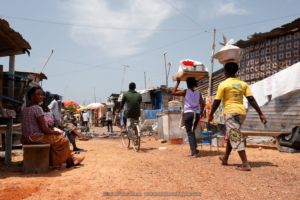 As the area is low-lying and flood prone, sawdust from a nearby timber mill has been used to reclaim an alleyway in Old Fadama. Colloquially referred to as 'Sodom and Gomorrah, Old Fadama is located in Ghana's capital Accra and is home to some some 80,000 people.