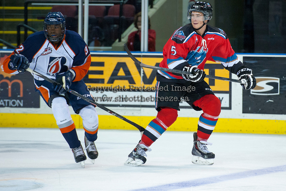 KELOWNA, CANADA - AUGUST 30: Kamloops Blazers prospect #32 Jermaine Loewen skates against Dalton Yorke #5 of the Kelowna Rockets on August 30, 2014 during pre-season at Prospera Place in Kelowna, British Columbia, Canada.   (Photo by Marissa Baecker/Shoot the Breeze)  *** Local Caption *** Jermaine Loewen; Dalton Yorke;