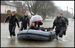 The Royal Engineers rescue residents in flood hit Egham, United Kingdom, Wednesday, 12th February 2014. Picture by Andrew Parsons / i-Images