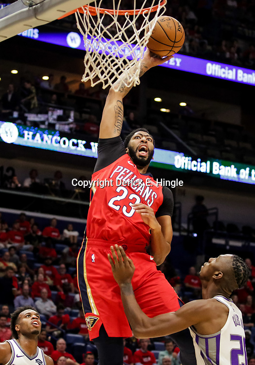 Oct 19, 2018; New Orleans, LA, USA; New Orleans Pelicans forward Anthony Davis (23) dunks over Sacramento Kings forward Harry Giles (20) during the first quarter at the Smoothie King Center. Mandatory Credit: Derick E. Hingle-USA TODAY Sports