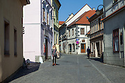 Streets leading away from the main square  in the South Bohemian city of Tabor. A group of Jan Hus followers came to a hill where a Premyslid settlement used to be and they founded a town there in the year 1420 and gave it a Biblical name - Tabor. Being led by captains Jan Zizka of Trocnov and Prokop Holy they started out on their victorious battles from there. The foundation of Tabor is connected with the name of Jan Hus, a great reformer of the Catholic Church. In the year 1437 after the Hussites were defeated, the town of Tabor was granted a royal charter by the Holy Roman Emperor and Czech King Sigismund of Luxembourg.