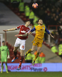 Nottingham Forest's Greg Halford battles with Preston North End's Joe Garner - Photo mandatory by-line: Matt Bunn/JMP - Tel: Mobile: 07966 386802 24/01/2014 - SPORT - FOOTBALL - City Ground - Nottingham - Nottingham Forest v Preston North End - FA Cup - Fourth Round
