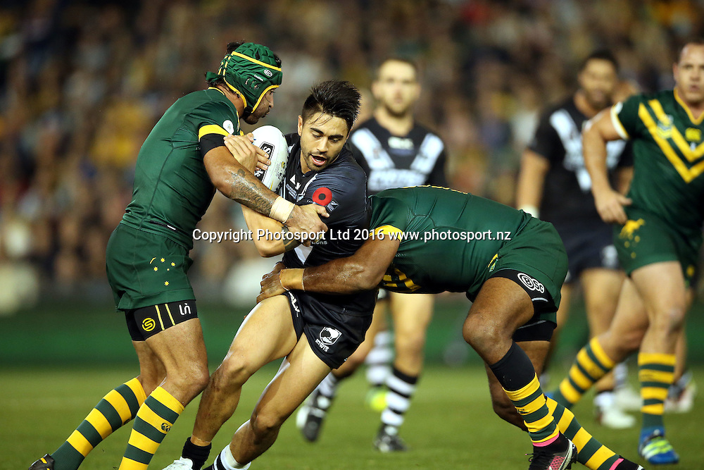 Shaun Johnson tackled by Greg Inglis and Johnathan Thurston<br /> Trans Tasman NZRL Kiwis v Australia Test Match at Hunter Stadium, Newcastl,e Australia. Friday 6 May 2016. Photo: Paul Seiser / www.photosport.nz