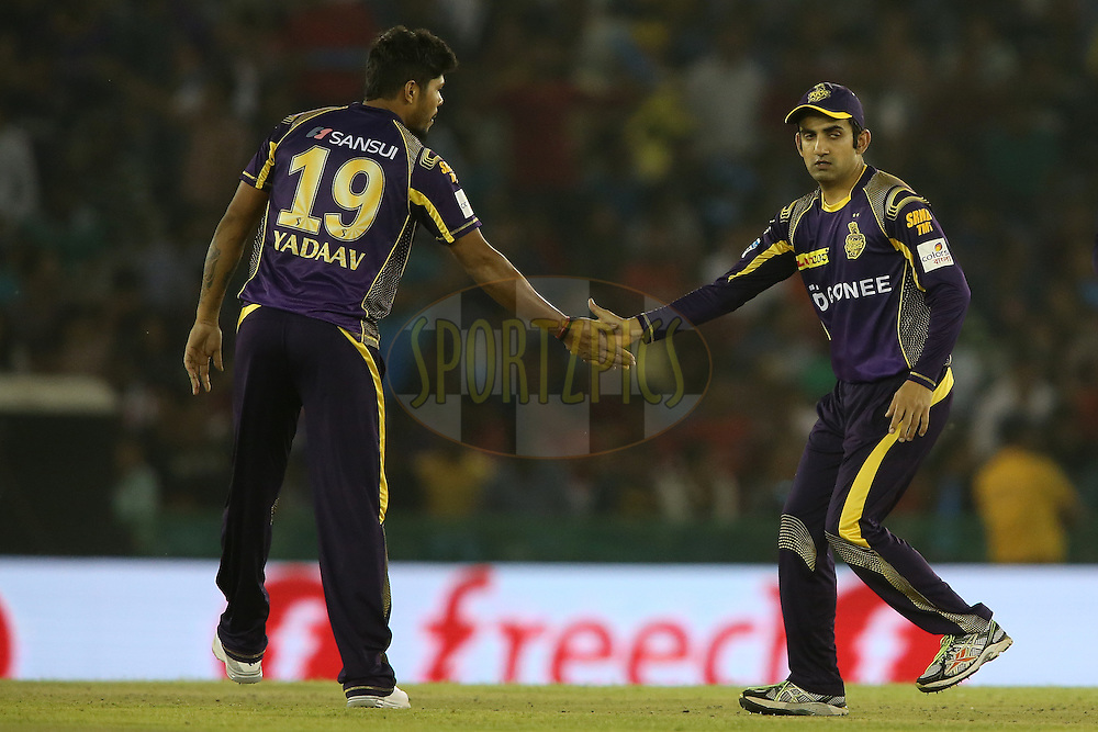 Umesh Yadav of Kolkata Knight Riders is congratulated by Kolkata Knight Riders captain Gautam Gambhir for getting Akshar Patel of Kings XI Punjab wicket during match 13 of the Vivo Indian Premier League (IPL) 2016 between the Kings XI Punjab and the Kolkata Knight Riders held at the IS Bindra Stadium, Mohali, India on the 19th April 2016<br /> <br /> Photo by Shaun Roy / IPL/ SPORTZPICS