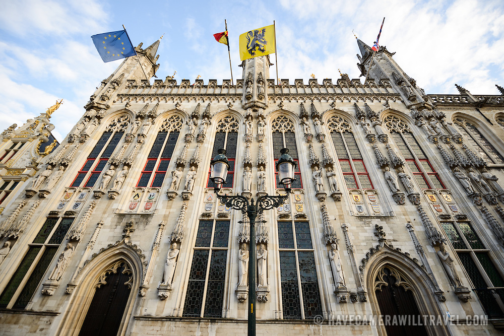Bruges' City Hall (or Stadhius) dates back to 1376 and features ornate Gothic architectural. On the front of the building are a number of statues and shields signifying the cities and towns that were under administrative rule of Bruges.