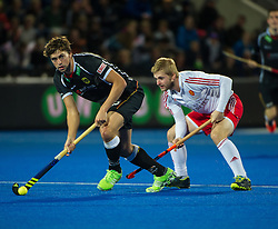 Germany's Florian Fuchs is watched by Ashley Jackson of England. England v Germany - Semi-Final Unibet EuroHockey Championships, Lee Valley Hockey & Tennis Centre, London, UK on 27 August 2015. Photo: Simon Parker