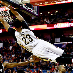 Mar 3, 2017; New Orleans, LA, USA; New Orleans Pelicans forward Anthony Davis (23) dunks over San Antonio Spurs forward Kawhi Leonard (2) during the first quarter of a game at the Smoothie King Center. Mandatory Credit: Derick E. Hingle-USA TODAY Sports