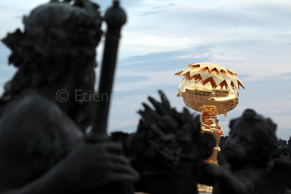 """Takashi Murakami 's """"Oval Buddha"""" stands outside in the Chateau de Versailles garden. The exhibition of the Japanese artist will open from September 14  2010 until December 12 despite opposition from French traditionalists..13 september 2010.  Etienne de Malglaive"""