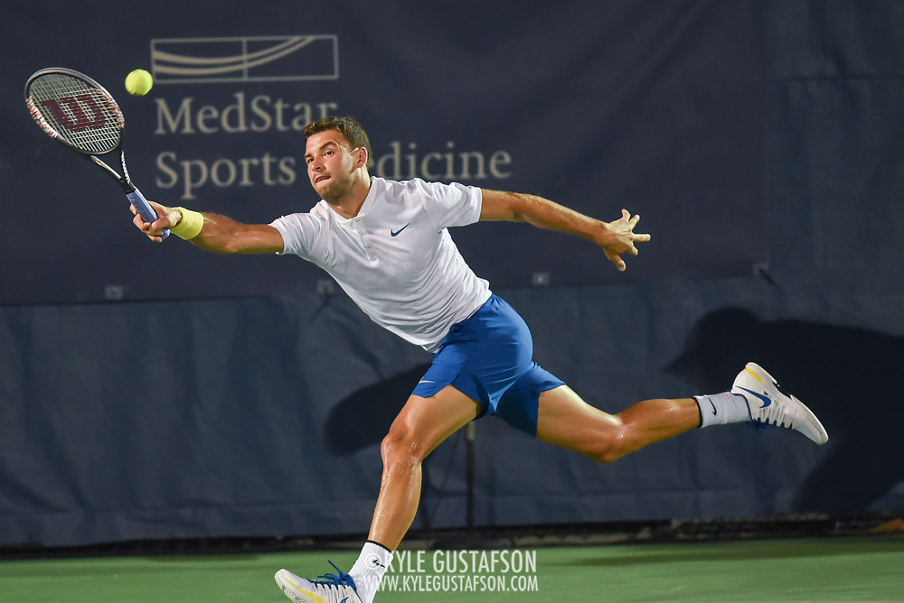 GRIGOR DIMITROV hits a forehand during his second round match at the Citi Open at the Rock Creek Park Tennis Center in Washington, D.C.