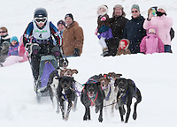 Rachael Colbath of Gilford leads her dogs out onto the Open Class course for the 82nd annual Laconia World Championship Sled Dog Derby Sunday afternoon.  (Karen Bobotas/for the Laconia Daily Sun)