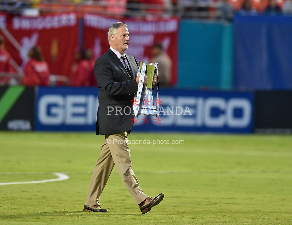 MIAMI, USA - Monday, August 4, 2014: A man wearing chinos walks out with the trophy before the International Champions Cup Final match at the SunLife Stadium on day fifteen of the club's USA Tour. (Pic by David Rawcliffe/Propaganda)