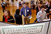 16704College of Communication Career Fair : Photos by Colby Ware..10/25/04--Emily Rowe, Matthew Falk and Dustin Torres speak with Clear Channel representatives at the Communications Career Fair in Baker Center.