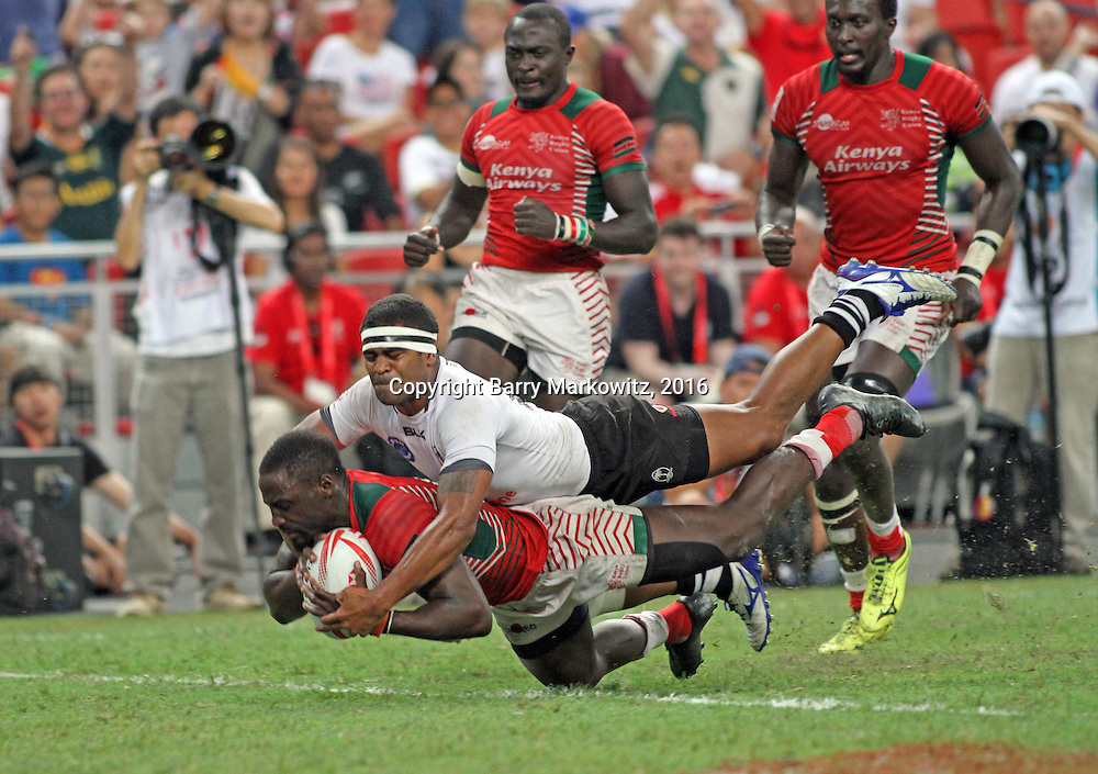 Kenya 7's, Collins Injera his first of two tries in the startling 30-7 upset of traditional power Fiji in the Cup Final Championship at the Singapore 7's, day 2 finals, Singapore National Stadium, Singapore.  Photo by Barry Markowitz, 4/17/16