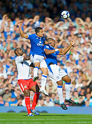 LIVERPOOL, ENGLAND - Sunday, September 20, 2009: Everton's Tim Cahill and Sylvain Distin and Blackburn Rovers' Jason Roberts during the Premiership match at Goodison Park. (Pic by David Rawcliffe/Propaganda)