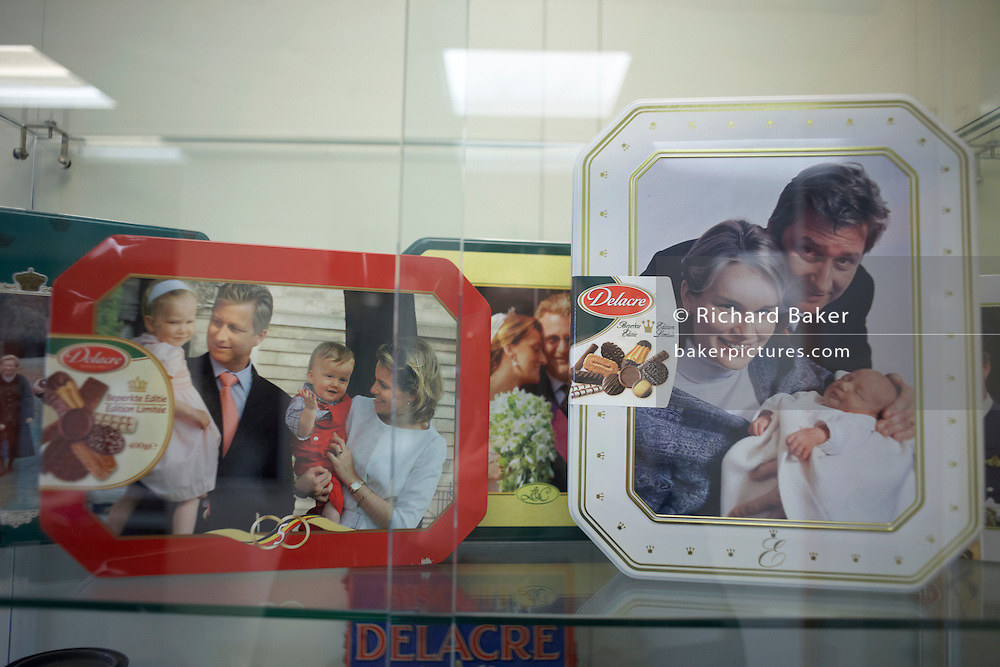Belgian Royal family Prince Philippe and Princess Matilda on biscuit tins at the Delacre biscuit production factory, Lambermont