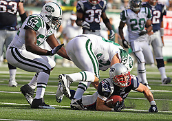 Sept 19, 2011; East Rutherford, NJ, USA; New York Jets safety Eric Smith (33) tackles New England Patriots wide receiver Wes Welker (83) during the 1st half at the New Meadowlands Stadium.