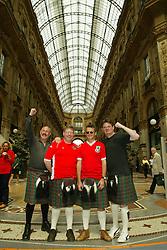 MILAN, ITALY - Friday, September 5, 2003: Wales fans (l-r) John Wake (Cardiff), Paul Saunders (Pontyclun), Jamie Borley (Swansea) and Ian Picton (Aberdeen) wearing Welsh St David's kilts at the Galleria Vittorio Emanuele II in Milan. (Pic by David Rawcliffe/Propaganda)
