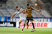 STOCKHOLM, SWEDEN - MARCH 12: Jonathan Augustinsson of Djurgardens IF and Daleho Irandust of BK Hacken competes for the ball during the Swedish Cup Quarterfinal between Djurgardens IF and BK Hacken at Tele2 Arena on March 12, 2018 in Stockholm, Sweden. Photo by Nils Petter Nilsson/Ombrello<br /> ***BETALBILD***