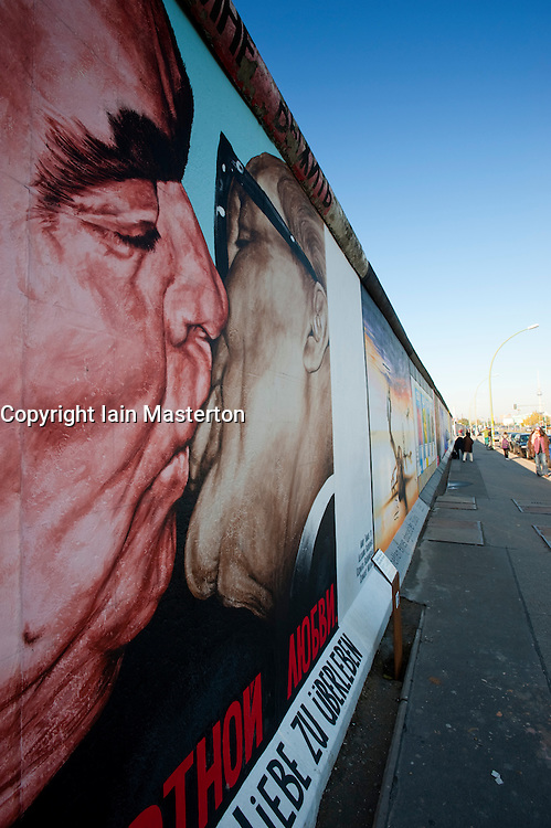 newly repainted mural of the famous kiss between Brezhnev and Honecker on Berlin Wall at the East Side Gallery in Kreuzberg Berlin