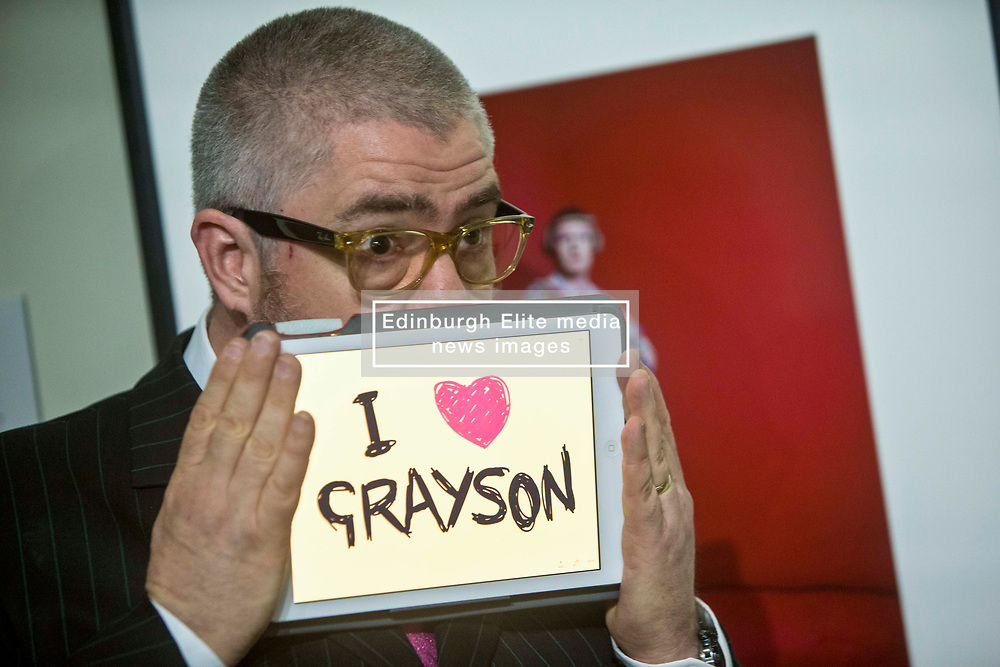 Pictured: Phill Jupitus sketches a picture of the artist Grayson Perry from a portrait by Richard Ansett, at the Scottish National Portrait Gallery, The celebrated, award-winning stand-up comic, performance poet and broadcast personality Phill Jupitus will return to the National Galleries of Scotland this summer with Sketch Comic. Part of the Edinburgh Fringe Festival, the show highlights his deep love of art and follows on from the success of two hugely popular runs in 2014 and 2015.<br /> <br /> <br /> <br /> Michael Schfield   EEm 17/7/2017