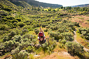 Woman zip lining in the Snake River Canyon with Zip the Snake in Twin Falls, Idaho.