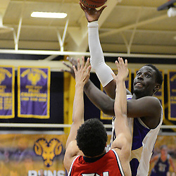 Staff photos by Tom Kelly IV<br /> West Chester's Eric Frans (24) goes up for a layup over Shippensburg's Marcus Williams (34) during the Shippensburg at West Chester University men's basketball game on Saturday, February 15, 2014.