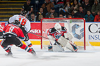 KELOWNA, CANADA - NOVEMBER 5: Michael Herringer #30 of the Kelowna Rockets misses a save on a shot by Max Gerlach #16 of the Medicine Hat Tigers during first period on November 5, 2016 at Prospera Place in Kelowna, British Columbia, Canada.  (Photo by Marissa Baecker/Shoot the Breeze)  *** Local Caption ***