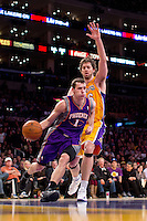 16 November 2012: Guard (1) Goran Dragic of the Phoenix Suns drives to the basket while being defended by (16) Pau Gasol of the Los Angeles Lakers during the second half of the Lakers 114-102 victory over the Suns at the STAPLES Center in Los Angeles, CA.