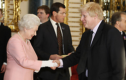 The Queen with London Mayor Boris Johnson (right) during a reception for G20 leaders at Buckingham Palace in London.