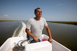 07 June 2010. Pointe aux Chenes, Louisiana.<br /> Fading away. Russel Darden, a shrimper, crabber, oysterman, fisherman. Russel holds over $1,000 worth of various fishing permits issued by the state. At present, all his fishing grounds are closed. He can not make use of any of the permits and he can not earn the money to make up the money. Russel is a member of the Pointe aux Chenes Indians, settlers that can trace their roots beyond 5 generations back to France. French cajun is the language of the elders, but is dying out in the children of today. BP's catastrophic oil spill threatens the tribe's very existence, their way of life and the land on which they live. Not recognised by the federal government, the 680 member tribe struggles for funds in a small community that survives only because of fishing and oil extraction in the Gulf of Mexico.<br /> Photo; Charlie Varley/varleypix.com