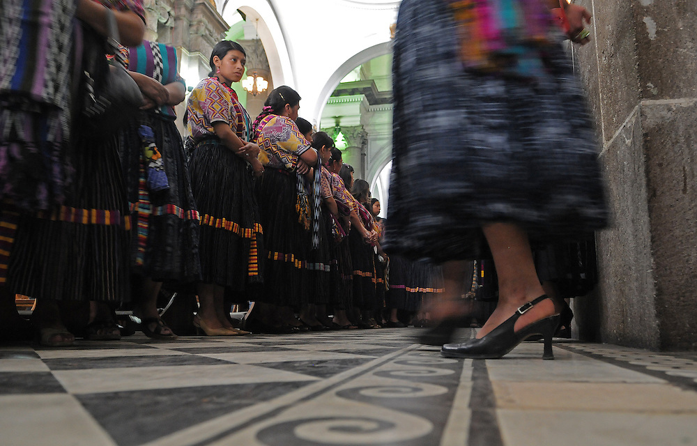 Apr 21, 2011 - Quetzaltenago, Guatemala - Dressed in traditional clothing from Quetzaltenago female members of the Nazarene Brotherhood line a pathway in the Cathedral for the start of the Procession of the Just Judge. The Procession of the Just Judge will take the Saint Statues to the President of the Nazarene brotherhood's home, before being brought back to the Cathedral Friday...(Credit Image: © Josh Bachman/ZUMA Press)