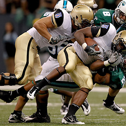 October 9, 2010; New Orleans, LA, USA;  Army Black Knights running back Raymond Maples (1) is tackled by Tulane Green Wave linebacker Trent Mackey (20) during the first half at the Louisiana Superdome.  Mandatory Credit: Derick E. Hingle