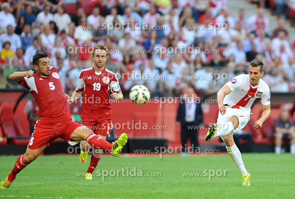 13.06.2015, Nationalstadion, Warschau, POL, UEFA Euro 2016 Qualifikation, Polen vs Greorgien, Gruppe D, im Bild ALEKSANDRE AMISULASHVILI, ARKADIUSZ MILIK // during the UEFA EURO 2016 qualifier group D match between Poland and Greorgia at the Nationalstadion in Warschau, Poland on 2015/06/13. EXPA Pictures &copy; 2015, PhotoCredit: EXPA/ Pixsell/ RAFAL RUSEK<br /> <br /> *****ATTENTION - for AUT, SLO, SUI, SWE, ITA, FRA only*****