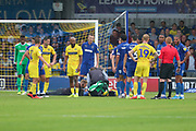 Wycombe Wanderers midfielder Matthew (Matt) Bloomfield (10) down injured during the EFL Sky Bet League 1 match between AFC Wimbledon and Wycombe Wanderers at the Cherry Red Records Stadium, Kingston, England on 31 August 2019.